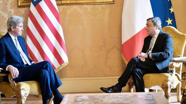 rome-italy-14-05-2021-a-handout-picture-made-available-by-the-chigi-palace-palazzo-chigi-press-office-shows-italian-prime-minister-mario-draghi-r-with-us-special-climate-envoy-john-kerry-l-at-palazzo-chigi-rome-ita