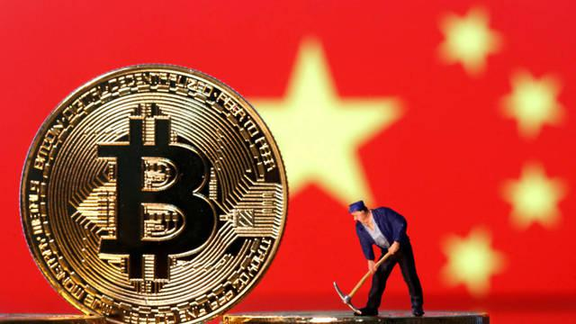 file-photo-a-small-toy-figurine-is-seen-on-representations-of-the-bitcoin-virtual-currency-displayed-in-front-of-an-image-of-china-s-flag-in-this-illustration-picture-april-9-2019-reuters-dado-ruvic-illustration-fi