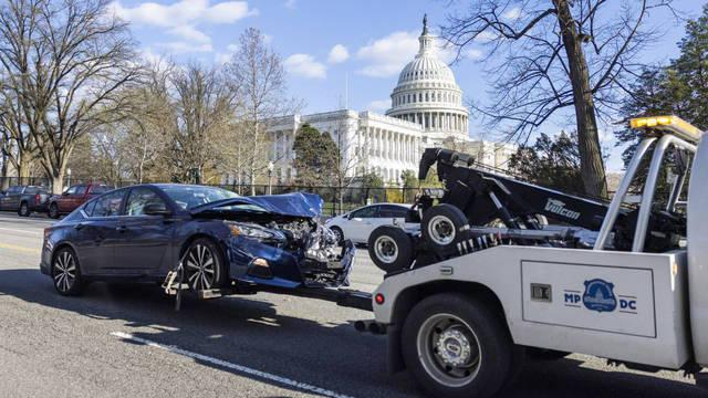washington-dc-usa-02-04-2021-officials-tow-the-vehicle-from-the-scene-after-it-rammed-a-barricade-outside-the-us-capitol-in-washington-dc-usa-02-april-2021-according-to-us-capitol-police-one-police-officer-was-kill