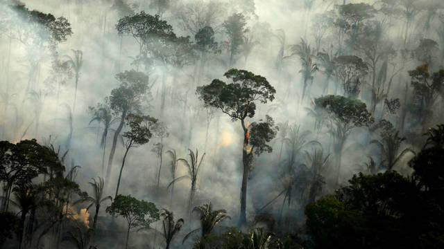 file-photo-smoke-billows-from-a-fire-in-an-area-of-the-amazon-rainforest-near-porto-velho-rondonia-state-brazil-september-10-2019-reuters-bruno-kelly-file-photo-file-photo